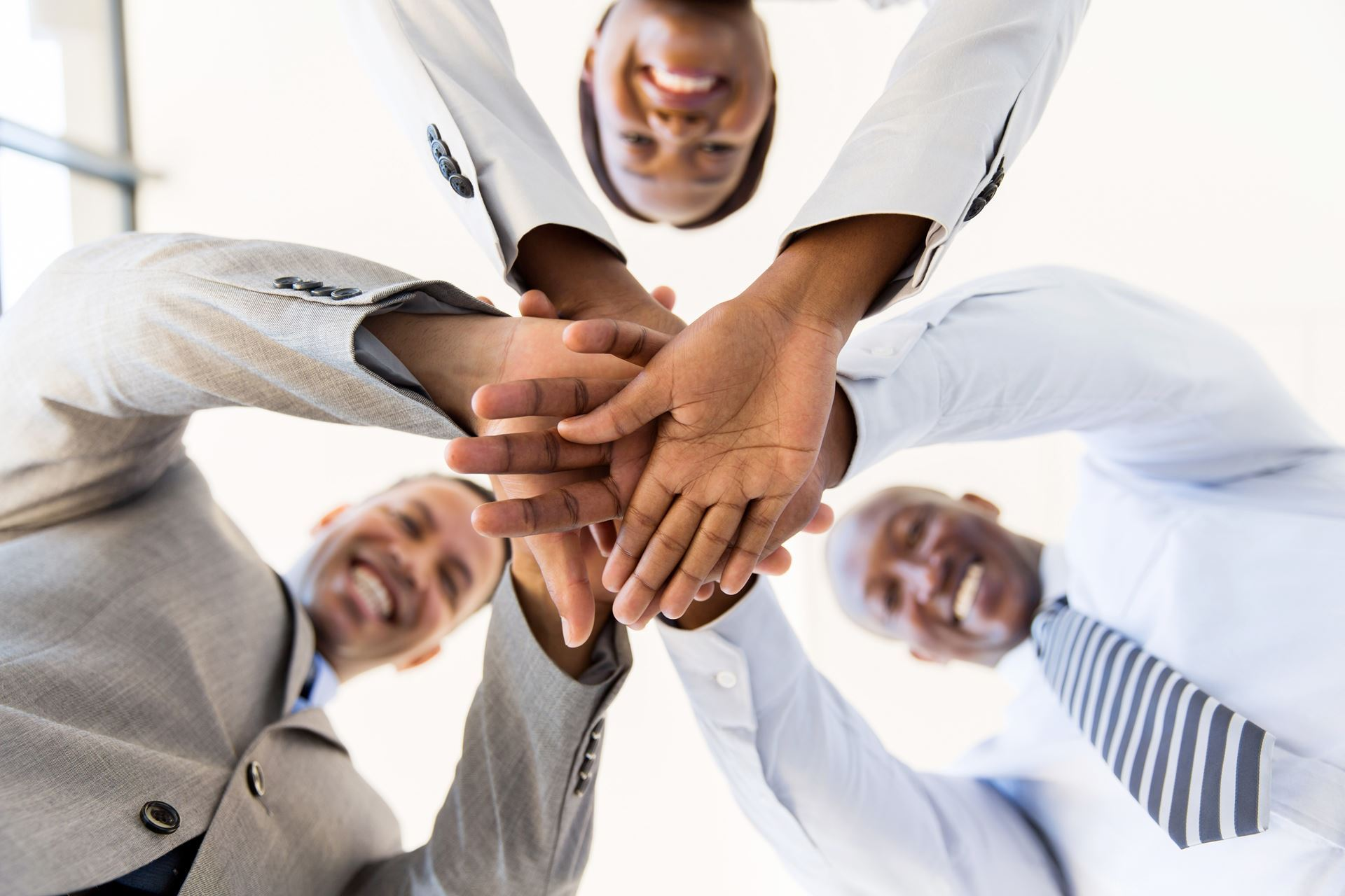 Partners - People in a group with hands together in unity